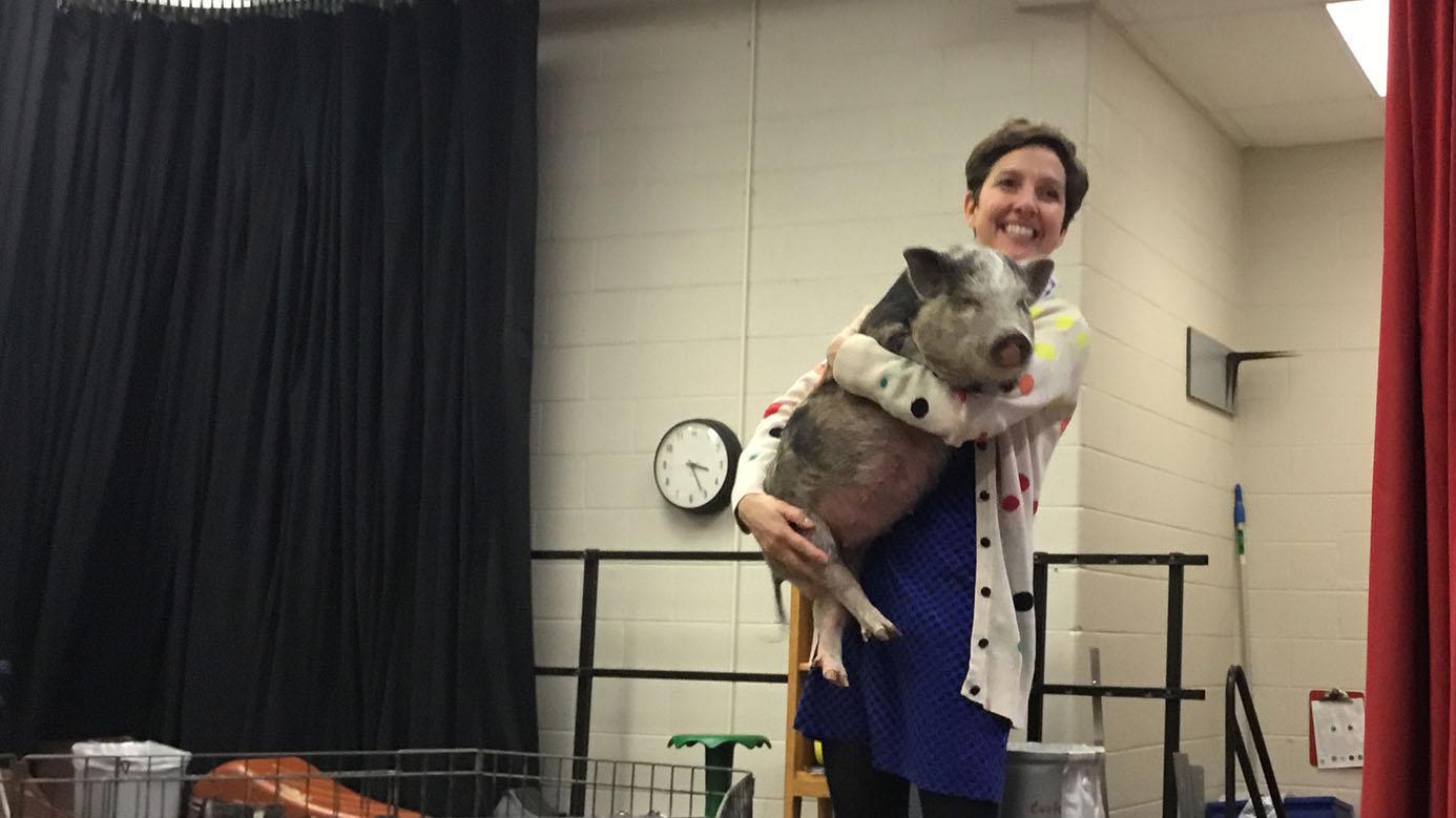 Read-A-Thon! Principal Lynne Wright kisses a pig…