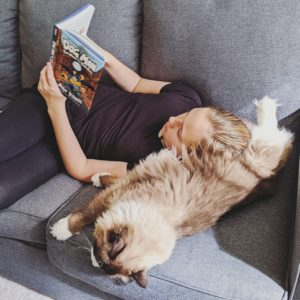 A student and her cat reading Dog Man